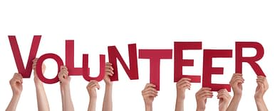 Many Hands Holding the red Letters Volunteer, Isolated